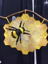"Rauga Bee by Debra Plestid of Tatamagouche, Nova Scotia ... ""Bee: symbol of the soul; messenger to the divine, with its ability to fly between the worlds of heaven and earth ... """