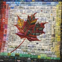 """From the World to Canada by Anita Payne, Perth, Ontario. Made of clothing labels with place names """"to represent the global origins of people and products that came to Canada."""""""