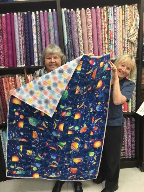 Linda and Heather, a quilt for North Shore Connexions Socety; Linda, SQG Community Quilts Committee, and Heather, NSCS board member and guild member