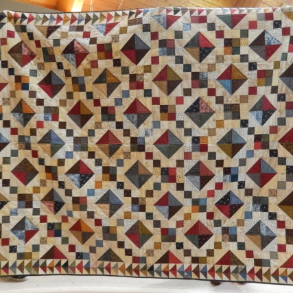 Julie's favourite quilt with fabric from six decades