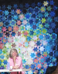 Dianne Stevenson with Fraser Valley Quilters' Guild raffle quilt at our May meeting