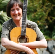 Cathy Miller with guitar