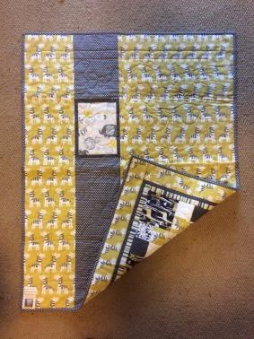 Community quilts - yellow-grey zebra back