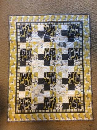 Community Quilts yellow-grey zebra back